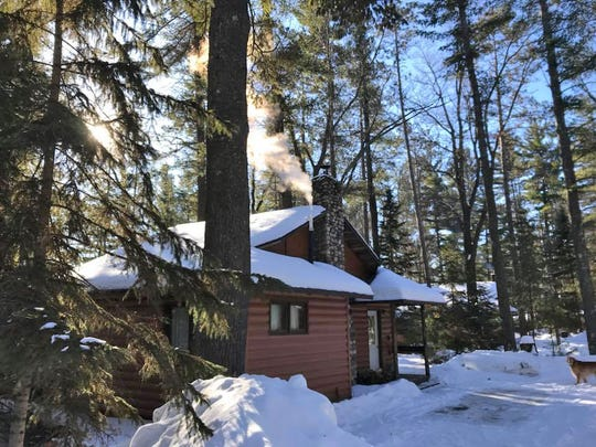 Snow surrounds a cabin at Black's Cliff Resort in Hazelhurst.