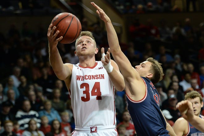 Wisconsin guard Brad Davison  drives to the basket against St. Mary's guard Kristers Zoriks on Tuesday night.