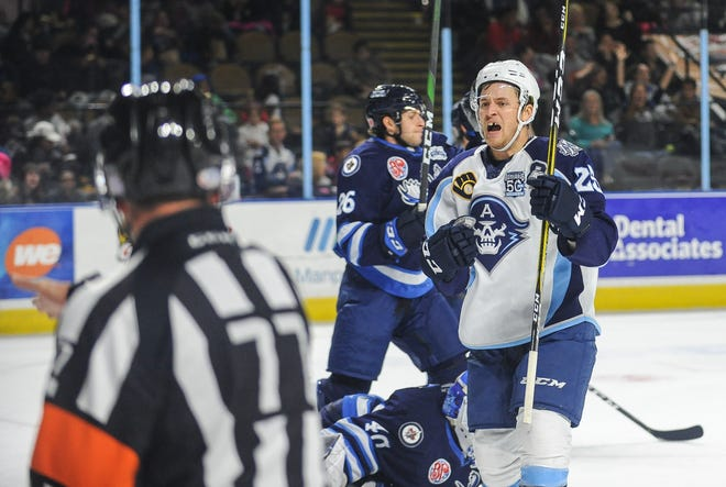 Milwaukee Admirals left wing Cole Schneider celebrates his goal against the Manitoba Moose in an a pre-pandemic American Hockey League game in November 2019. The Admirals and Moose are scheduled to meet 12 times in the coming season.