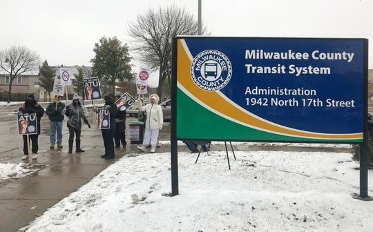 Members of the union representing Milwaukee County bus drivers and mechanics rally outside the Milwaukee County Transit System administration building as contract negotiations resumed Nov. 6.