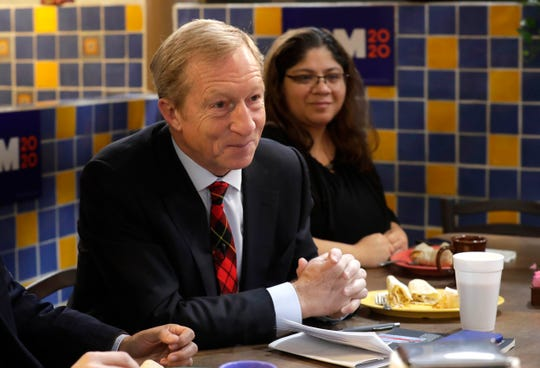 Democratic presidential candidate Tom Steyer greets people during a breakfast meeting with voters at Nuevo Mercado El Rey.