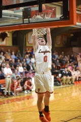 Viola's Blaine Marberry goes up for a slam dunk during the Longhorns' 70-44 victory over Norfork on Tuesday night.