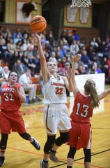 Viola's Keyaira Moore goes between Norfork's Riley Moody and Aaliyah Manes for a layup on Tuesday night.