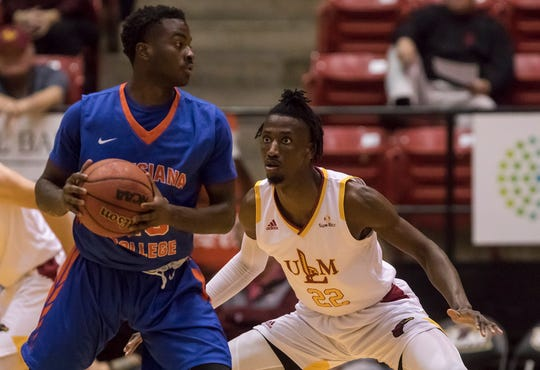 University of Louisiana at Monroe's D'Andre Bernard (22) guards against Louisiana College's Desmond Longino (20) during the first game of  ULM's basketball season at Fant-Ewing Coliseum in Monroe, La. on Nov. 5.