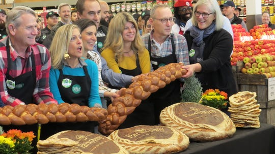 Whole Foods grand-opening in Parsippany: crew celebrates ceremonial bread-breaking. Nov. 6, 2019.