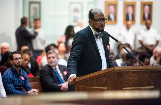 Pastor Edward Nettles speaks against the panhandling ordinance amendment during the city council meeting at city hall in Montgomery, Ala., on Tuesday November 5, 2019.