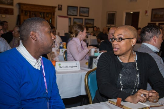 Two attendees participate in a discussion about vulnerability led by Col. Dede Halfhill, the director of Department of Defense Public Affairs Operations, at the Air University Suicide Awareness Summit, Oct. 30, 2019, Maxwell Air Force Base.