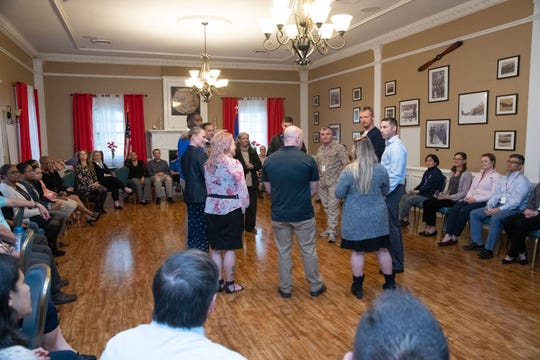 Attendees and speakers of the Air University Suicide Awareness Summit participate in a group exercise, Oct. 30, 2019, Maxwell Air Force Base.