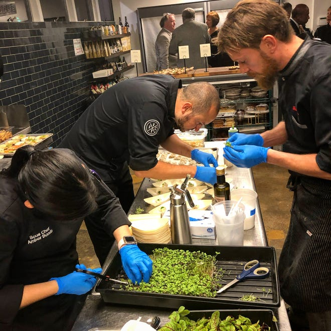 From left, Amber Bonds, Eric Rivera and Gianluca Tolla prepare dishes in Montgomery.