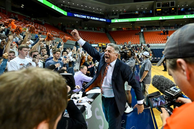 Auburn head coach Bruce Pearl cheers with the crowd after a win over Georgia Southern in an NCAA college basketball game Tuesday, Nov. 5, 2019, in Auburn, Ala. (AP Photo/Julie Bennett)