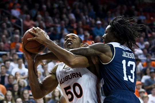 Georgia Southern guard Quan Jackson (13) fouls Auburn center Austin Wiley (50) during the second half of an NCAA college basketball game Tuesday, Nov. 5, 2019, in Auburn, Ala. (AP Photo/Julie Bennett)