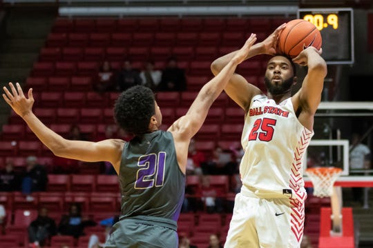 Ball State's Tahjai Teague shoots past a Defiance defender in their season opener at Worthen Arena Tuesday, Nov. 5, 2019. Ball State won 87-43.