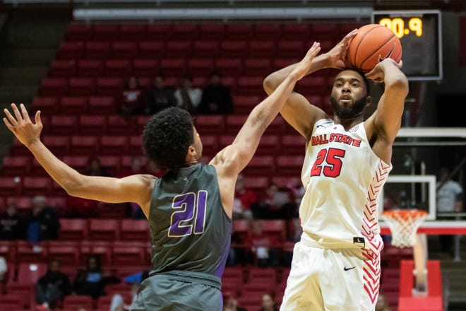 FILE -- Ball State's Tahjai Teague shoots past a Defiance defender in their season opener at Worthen Arena Tuesday, Nov. 5, 2019. Ball State won 87-43.