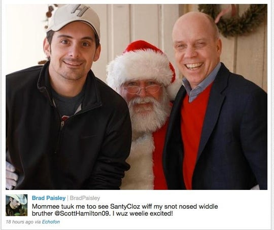 Brad Paisley, left, and Scott Hamilton pose with Santa Claus in 2011, and Paisley had a little fun with the caption on Twitter.