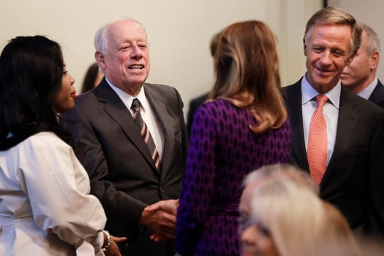 Former Democratic Gov. Phil Bredesen, second from left, and former Republican Gov. Bill Haslam, right, talk with audience members before a discussion on bipartisanship at Vanderbilt University Tuesday, Nov. 5, 2019, in Nashville, Tenn. (AP Photo/Mark Humphrey)