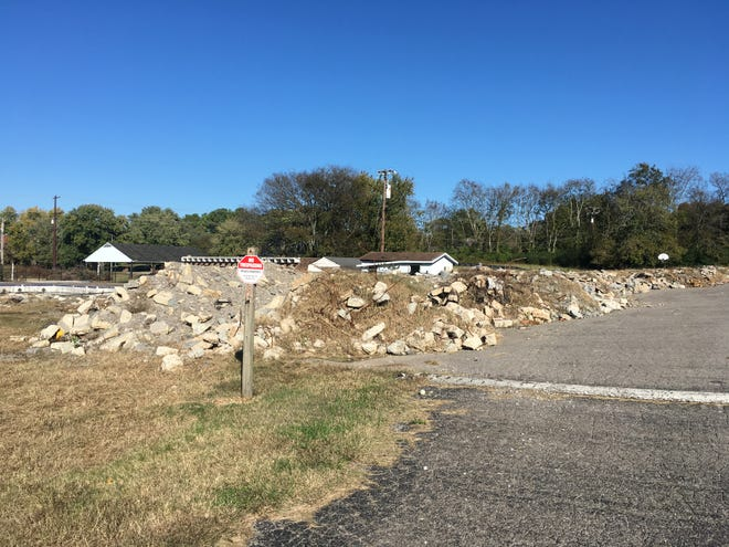 Piles of broken concrete and rubble sit at 502 Wilson Pike, the home of the former Dolphin Club in Brentwood, on Nov. 1. The property's owners planned to develop it into a private tennis club, but a series of lawsuits have put the project on hold.