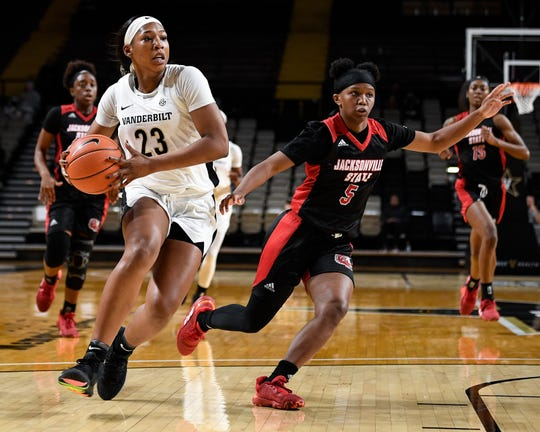 Vanderbilt forward Koi Love (23) advances past Jacksonville State guard Nekiyah Thompson (5) during the first half at Memorial Gym in Nashville, Tenn., Tuesday, Nov. 5, 2019.