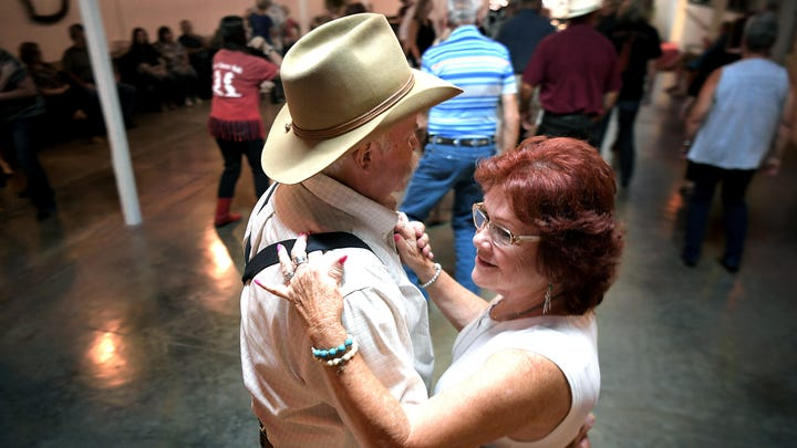 Paul Pitts and Cheryl Williams dance to the Stable Boys band during Len's Line Dancing at the Stables Event Center in Centerville, Tenn., on Sept. 3, 2019. Stables Event Center was once a Tennessee walking horse stable and a clothing factory, but two years ago, lifelong resident Lisa Marie Atkinson Blystad purchased the stables and turned it into an events center that hosts weddings, concerts, line dancing, wrestling, children's events and more.