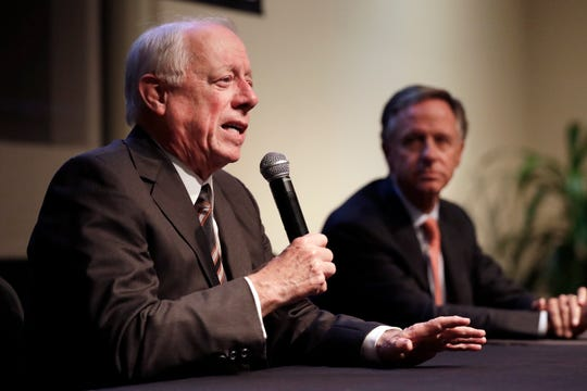 Former Democratic Gov. Phil Bredesen, left, answers a question during a discussion on bipartisanship at Vanderbilt University Tuesday, Nov. 5, 2019, in Nashville, Tenn. At right is former Republican Gov. Bill Haslam. (AP Photo/Mark Humphrey)