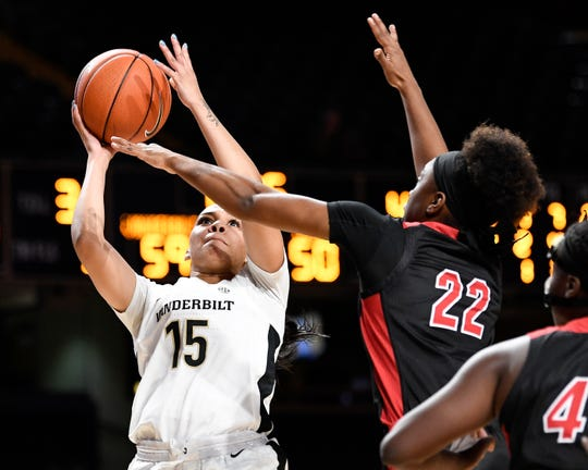 Vanderbilt forward Brinae Alexander (15) shoots past Jacksonville State forward Jayla Walker (22) during the second half at Memorial Gym in Nashville, Tenn., Tuesday, Nov. 5, 2019.