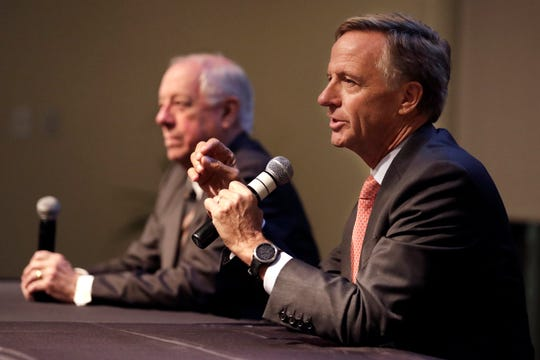 Former Republican Gov. Bill Haslam, right, answers a question during a discussion on bipartisanship at Vanderbilt University Tuesday, Nov. 5, 2019, in Nashville, Tenn. At left is former Democratic Gov. Phil Bredesen. (AP Photo/Mark Humphrey)