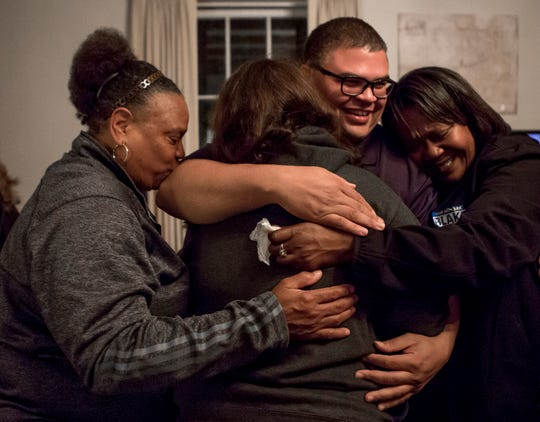 Jeremy Blake is embraced by his mother, Desiree, sister, Jerica and friend Lynnette Byrd after conceding the Newark Mayoral race to incumbent Jeff Hall.