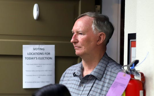 William Bayne Anderson listened for election results Tuesday in the clerk's office.