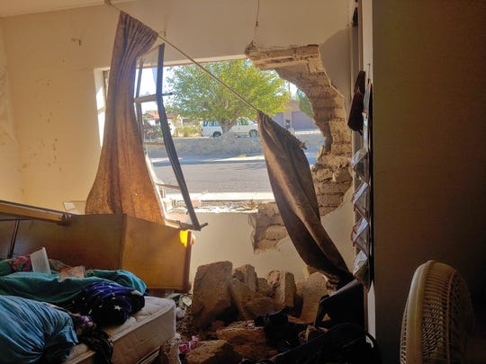 The aftermath after a car crashed through a bedroom of a home on the 700 block of S. Esperanza St. No injuries were reported.