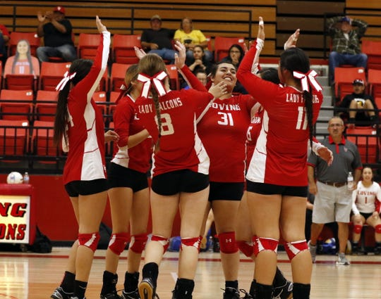 Loving celebrates a point won in the second set of Tuesday's district tournament game against Jal. Loving swept Jal in three sets and will face Eunice on Thursday in the district semifinals.