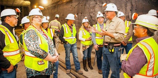 Gene Balsmeier, chief operating officer and deputy project manager of Nuclear Waste Partnership, WIPP's management and operations contractor, addresses a group of employees and family members in the WIPP underground.