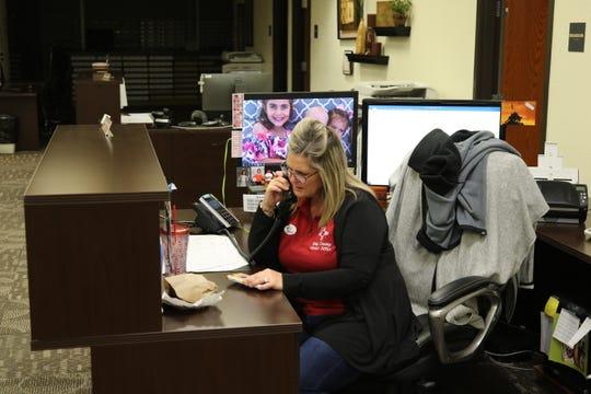 Eddy County Chief Deputy County Clerk Darlene Rosprim answers a phone Tuesday night at the Eddy County Clerk's office.
