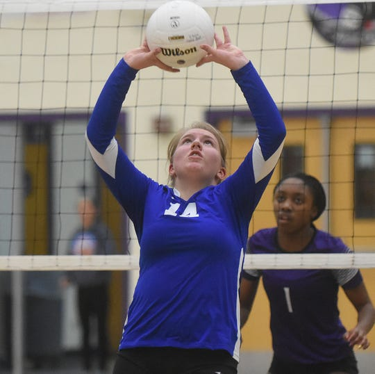 Carlsbad junior Harmony Lopez sets the ball in the second set of Tuesday's District 4-5A tournament match at Rock Staubus Gymnasium in Clovis.