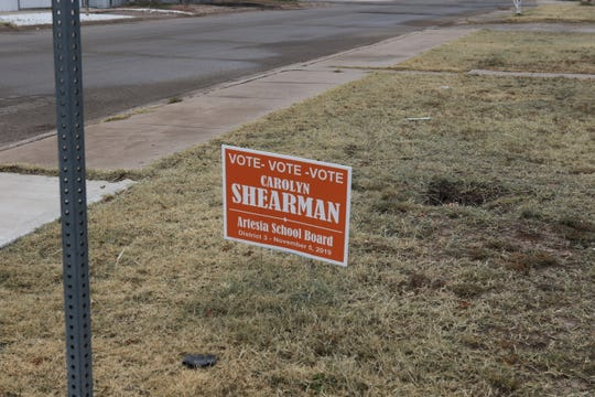 A Carolyn Shearman campaign sign adorns a yard in Artesia Wednesday. She and Cherie Widmayer faced off in the only contested election Tuesday in Eddy County. Widmayer defeated Shearman for the Artesia School Board District 3.