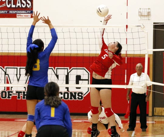 Loving's Faith McDOnald spikes the ball against Jal during their district tournament game on Nov. 5, 2019. Loving swept Jal in three sets. McDonald finished with three kills, four blocks and five digs in the win.