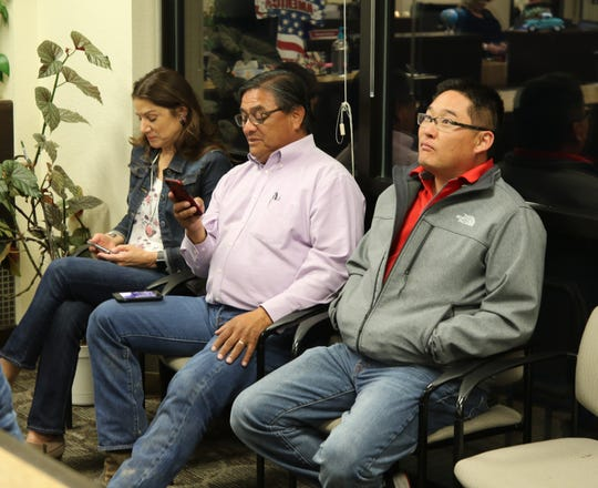 From left:Therese Rodriguez, Edward Rodriguez and Will Cho wait for election results Tuesday night at the Eddy County Clerk's office.