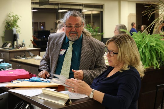 Dave Rogers and Julie McGee discuss election results Tuesday night at the Eddy County Clerk's office.