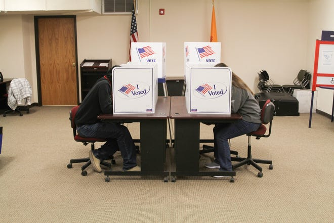 Two poll workers cast their votes at the Lincoln County Courthouse voting center in Carrizozo, NM on Tuesday, Nov. 5.