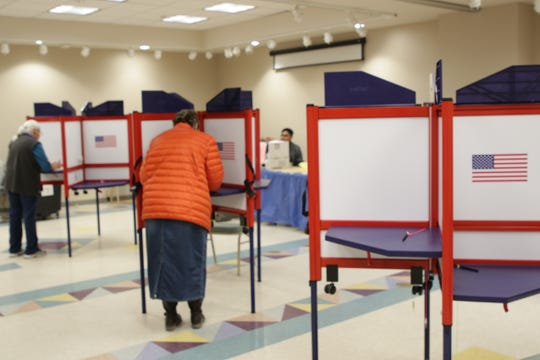 Voters mark ballots in Farmington, New Mexico on Election Day, Nov. 5, 2019.