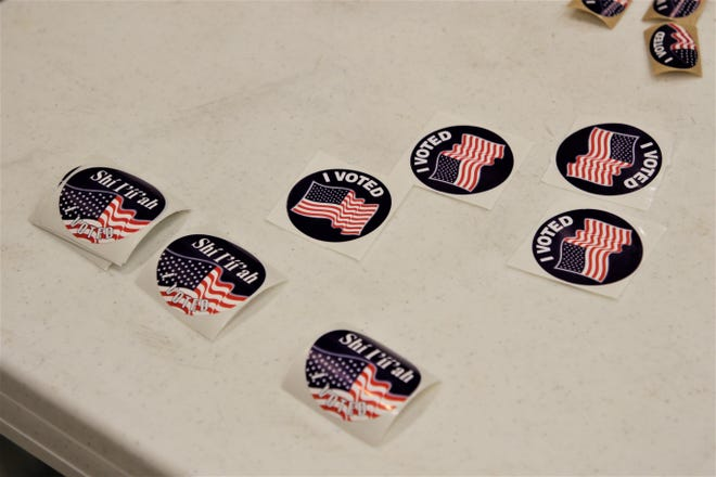 """""""I voted"""" stickers in both English and Navajo at the polling station inside Farmington Museum on Election Day, Nov. 5, 2019."""