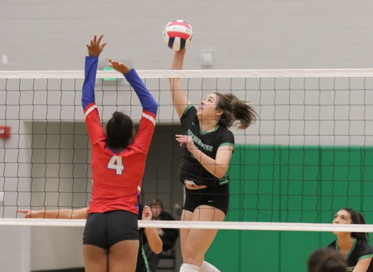 Farmington's Chloe Finch hits the ball down the right side for a kill against West Mesa during Tuesday's District 2-5A volleyball quarterfinals at Scorpion Arena in Farmington.