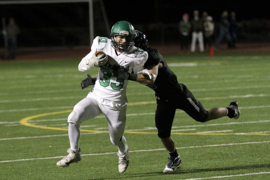 Farmington's Thomas Montoya tries to fight off Piedra Vista's Aiden Ackerman during a District 1-5A football game on Friday, Nov. 1 at Hutchison Stadium in Farmington.