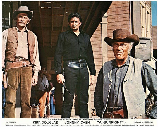 """A Gunfight"" lobby card shows the stars."