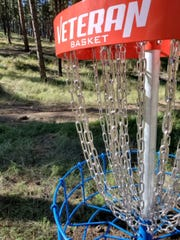 "One of the disc golf ""holes"" awaits players on the new course opened by the Parks and Recreation Department  on Moon Mountain."