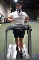 Ben Davis hits the treadmill on Nov. 5 wearing a breath analysis device. The device which monitors his breathing rate, oxygen used and heart rate, can give the U.S. Army Veteran an idea of how many calories he'll burn while exercising.