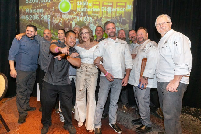 Karen Pendleton (center) celebrates a successful fundraiser with the participating chefs.