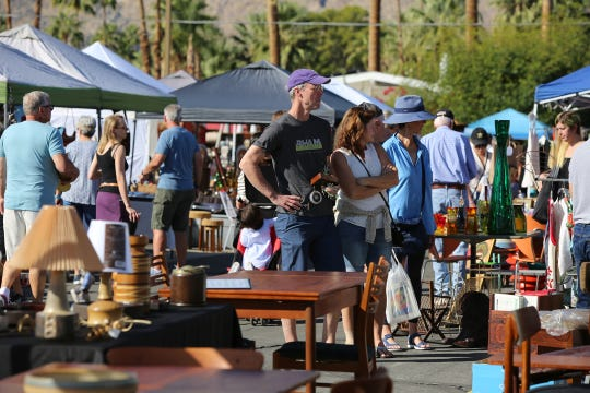 People shop for vintage items at the Palm Springs Vintage Market held outside the Palm Springs Cultural Center in Palm Springs, Calif., on Sunday, November 3, 2019.