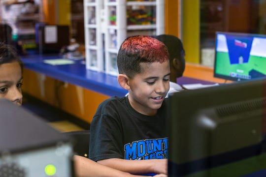 At the clubhouse in Indio, kids enjoy working on computers.