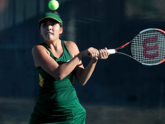 Coachella Valley's Lydia Rodriguez returns the ball to Beaumont's Ashlie Payan during the first round of CIF tennis playoffs at JW Marriott Desert Springs Resort in Palm Desert, Calif., on November 6, 2019.