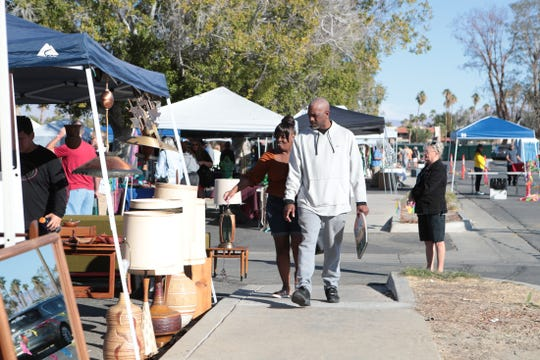 Montria Olabode, left, and Curtis Dunbar, both of Palm Springs, shop for vintage items at the Palm Springs Vintage Market held outside the Palm Springs Cultural Center in Palm Springs, Calif., on Sunday, November 3, 2019.
