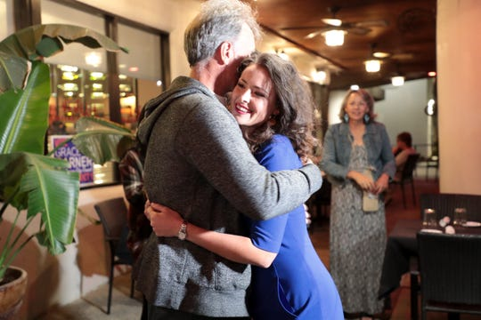 Grace Garner receives a hug upon arriving to her election night party on Tuesday, November 5, 2019 in Palm Springs, Calif.